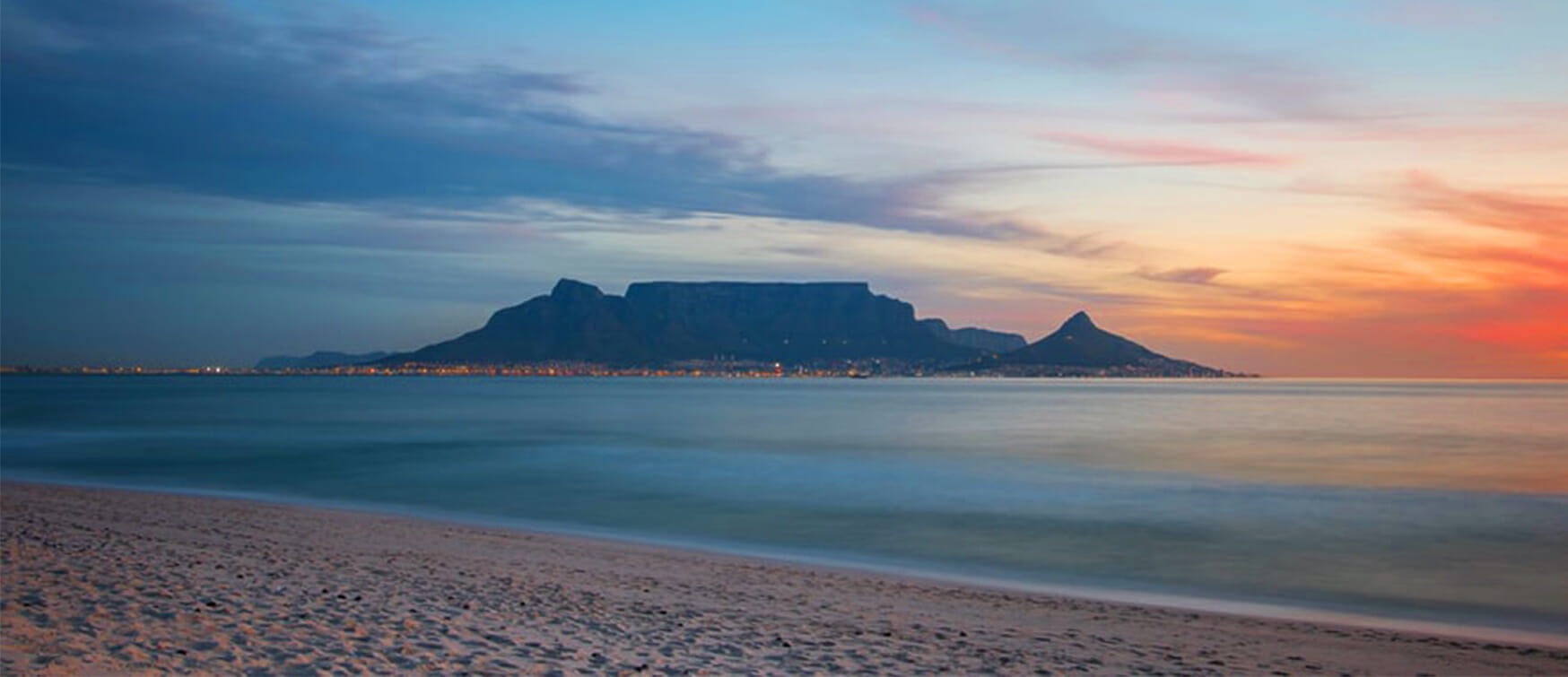 Sunset over Table Mountain | Breathtaking view of Tableview Mountain from the Bloubergstrand Coast, Cape Town