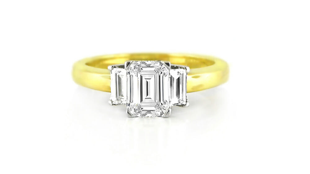 emerald cut and baguette diamond trilogy ring