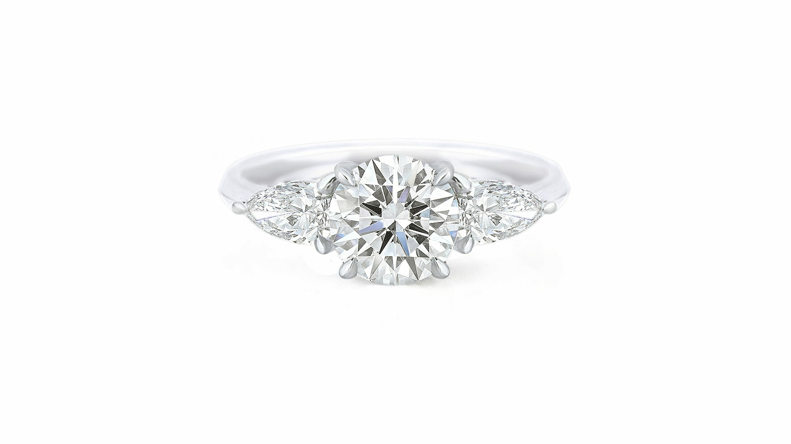 Round & Pear Diamond Trilogy Ring 2