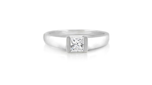 Tension Set Princess Diamond Solitaire Ring | An 18 carat white gold princess cut diamond solitaire ring in a semi tension setting