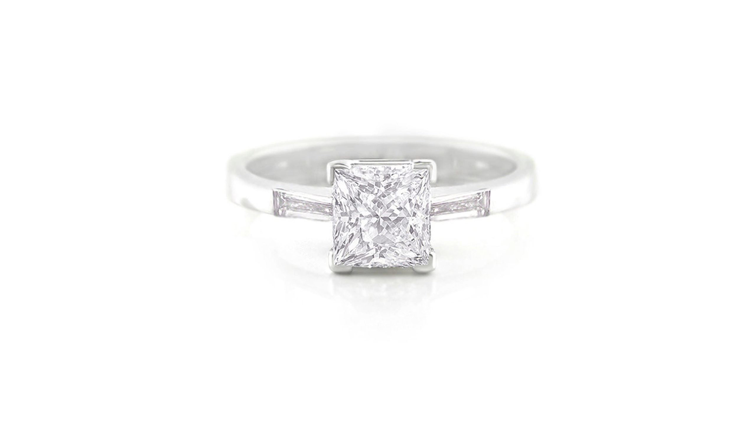 princess and baguette diamond engagement ring | 18 carat white gold diamond engagement ring