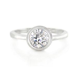 Tube Set Diamond Solitaire Ring 2 | An 18 carat white gold round brilliant cut diamond solitaire ring