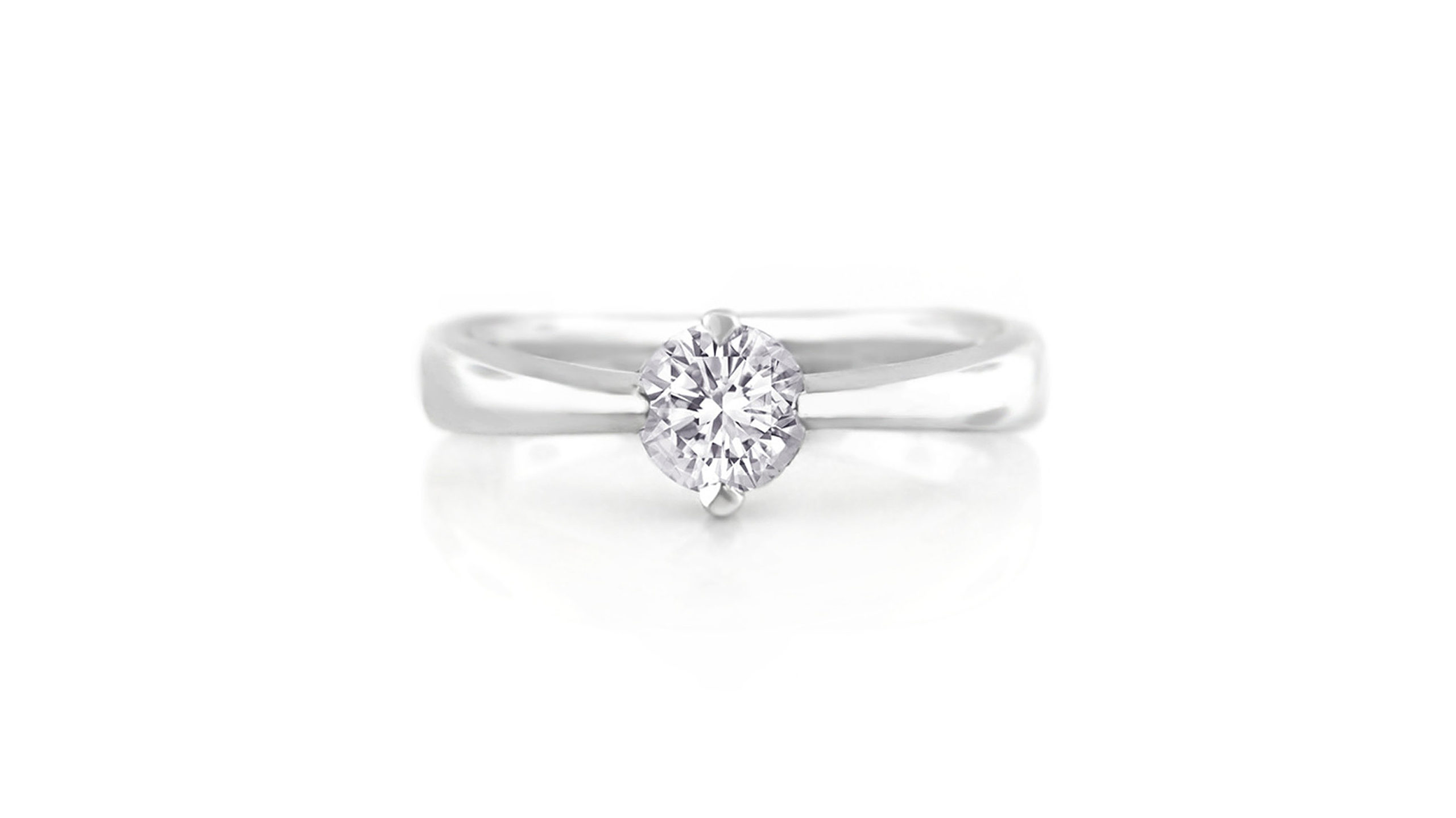 North-South-East-West Diamond Solitaire Ring | An 18 carat white gold diamond engagement ring