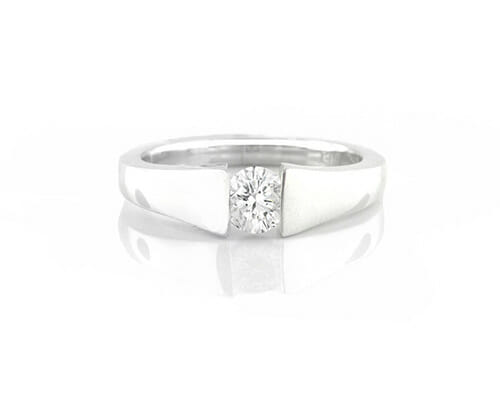 Solitaire Engagement Ring 015 | A diamond engagement ring, crafted in 18 carat white gold, set in a tension setting