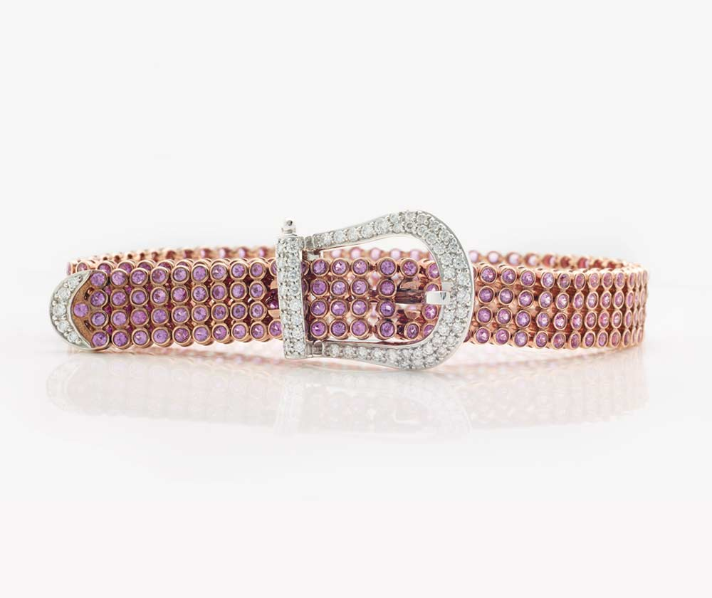 Pink sapphire coloured gemstone and diamond belt buckle bracelet | Rose and white gold