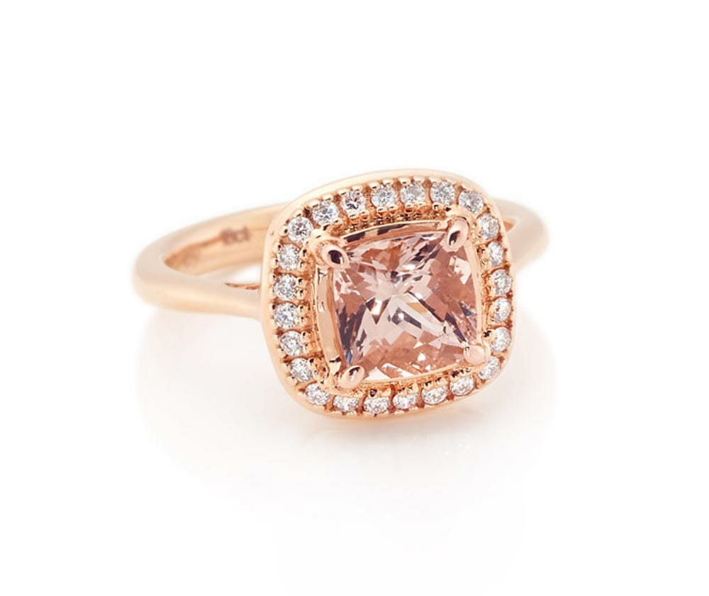 Cushion cut morganite coloured gemstone and diamond halo ring | Set in rose gold