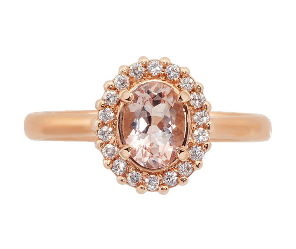 Oval morganite coloured gemstone and diamond halo ring