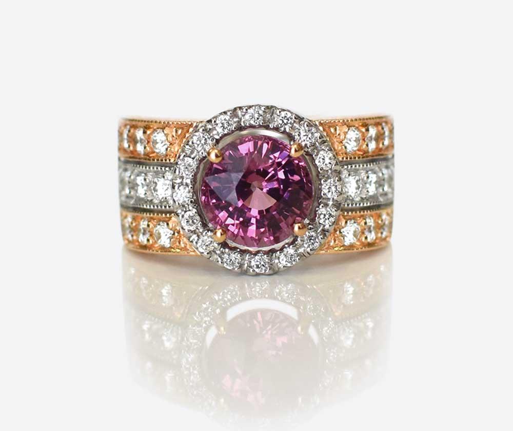 Garnet coloured gemstone and diamond ring