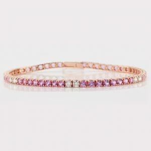 Rose Gold and Pink Sapphire Tennis Bracelet | A 14 carat rose gold bracelet with diamonds and pink sapphires