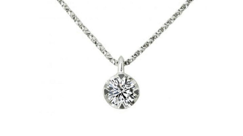 Claw-set solitaire diamond pendant