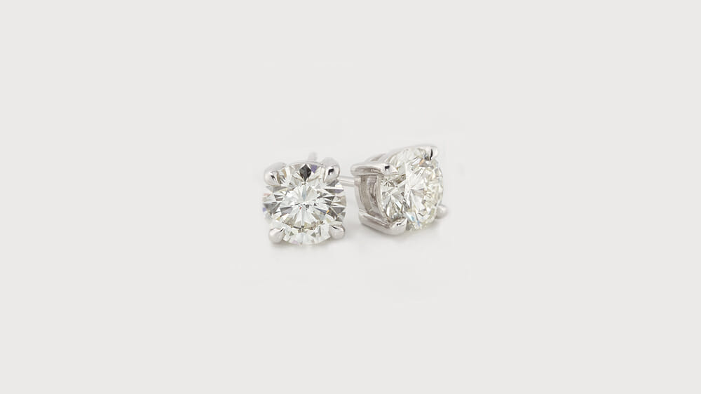 A pair of classic diamond solitaire stud earrings.