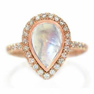 Moonstone & diamond halo ring set in rose gold