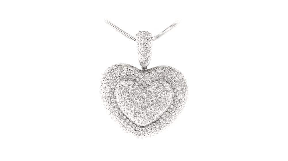 Pave-heart diamond pendant with diamond bale