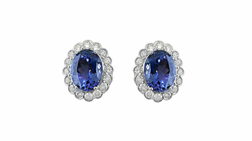Oval Tanzanite and diamond halo earrings | Set in 18 carat white gold