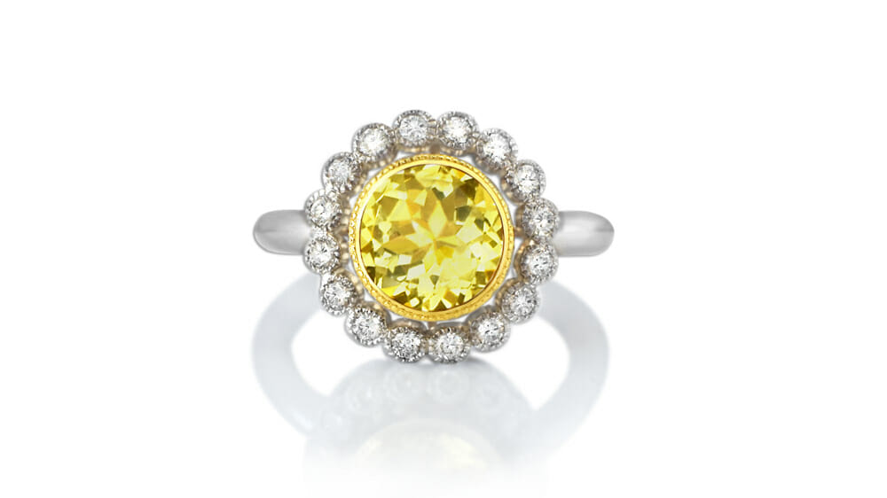 Danburite Ring | Contains gemstones and diamonds in a halo ring.