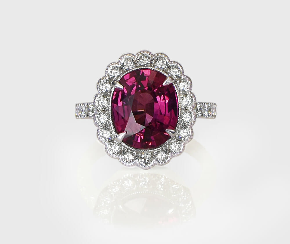 Rhodelite Gemstone Ring | Contains diamonds set in a halo ring.