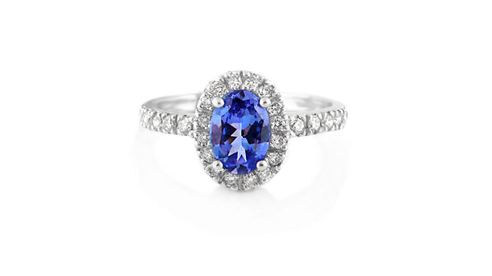 Tanzanite & Diamond Ring | Oval Tanzanite & Diamond Halo Ring with diamonds extending down the band