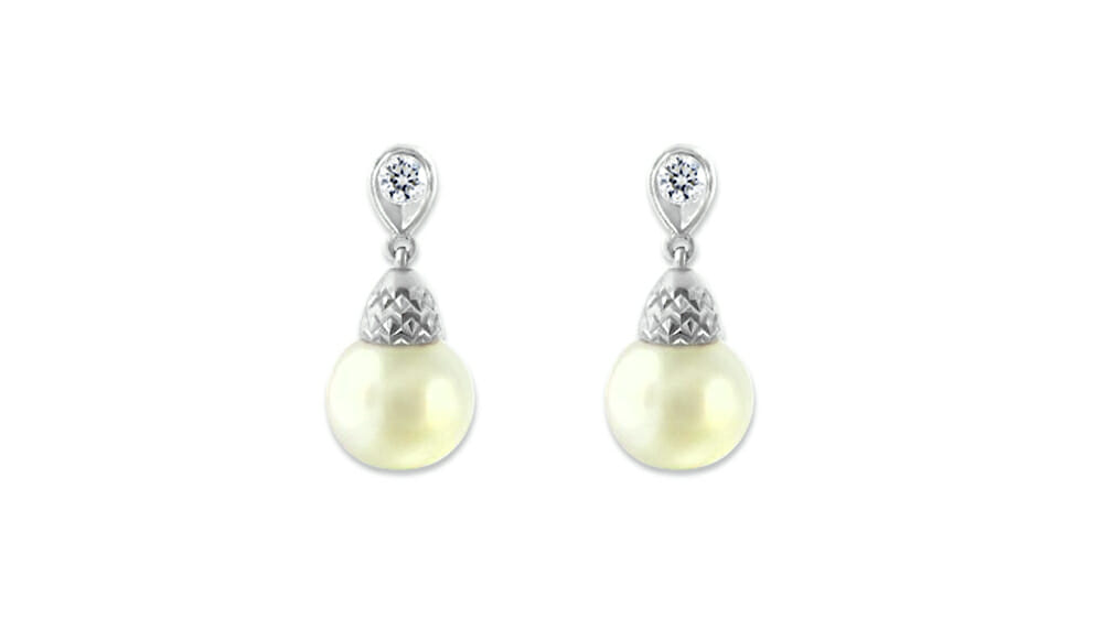 Pearl Earrings | Pearl and diamond drop earrings.