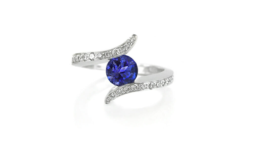 Tanzanite and Diamond | Bypass Ring with diamond band.