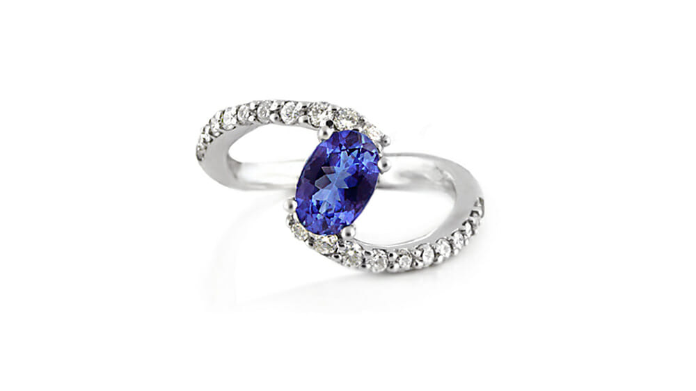 Tanzanite & Diamond Ring | Tanzanite ring with diamonds on the twirl band.