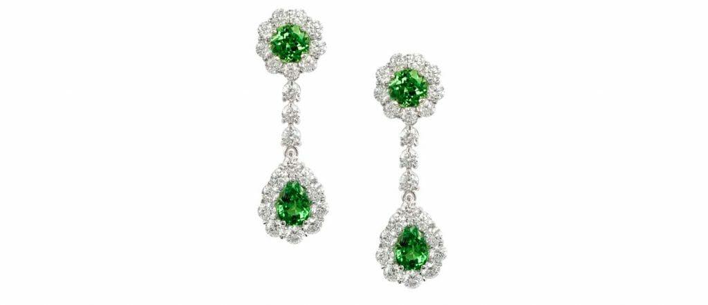 A pair of green Tsavorite & Diamond Drop Earrings set in 18ct white gold