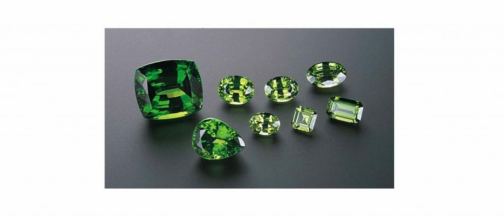 Tsavorite is a green to yellowish green garnet. All these stones were cut from the same piece of rough. The largest stone weighs 23.23 carats. - Courtesy Menavi Quality Cut Ltd.