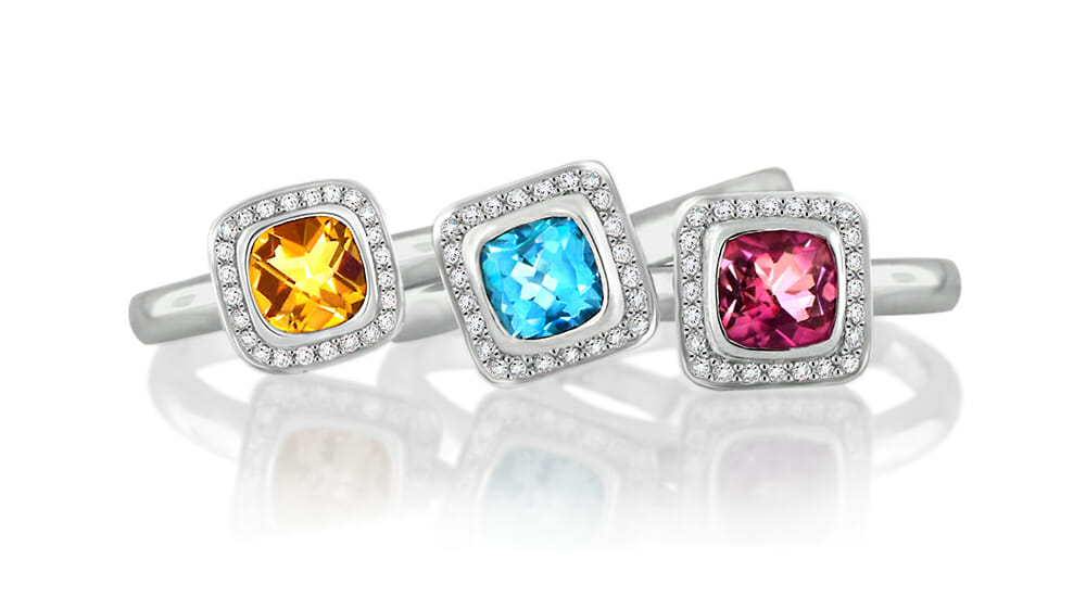 Set of three coloured gemstone stack rings with diamond halos