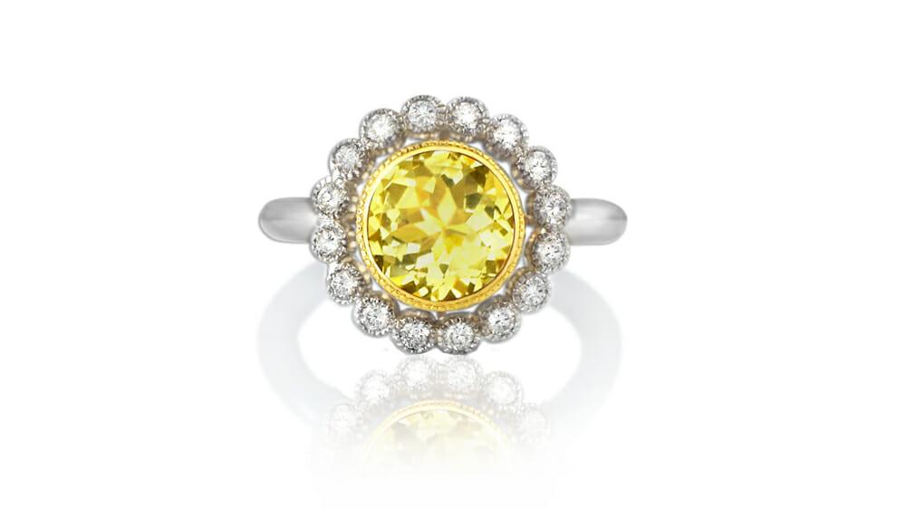 Danburite coloured gemstone and daisy diamond halo ring   Set in white gold