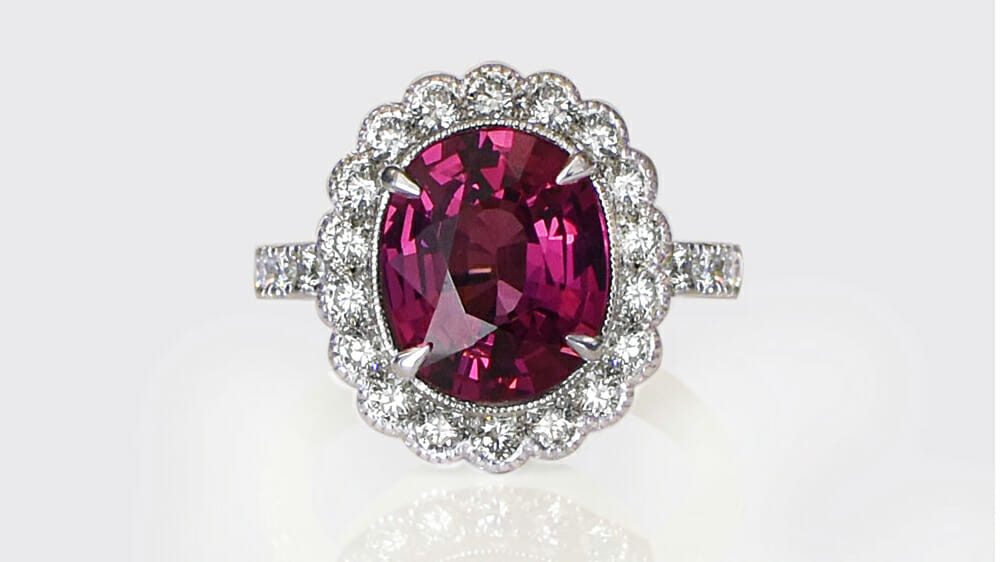 Rhodalite coloured gemstone and diamond halo ring