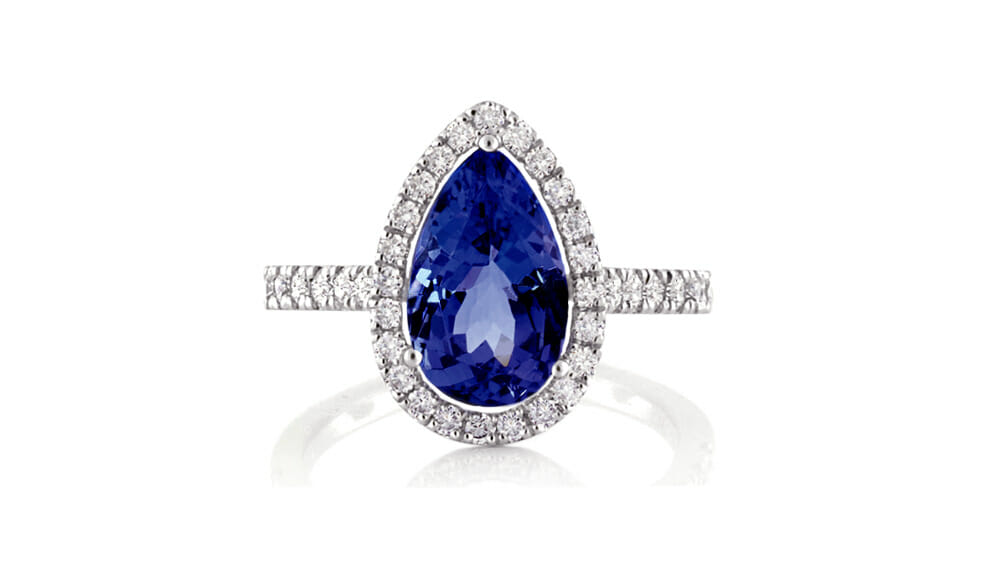 African Pear Tanzanite and Diamond Halo Ring | A pear cut tanzanite surrounded by a halo of diamonds, with sparkling diamonds down the band