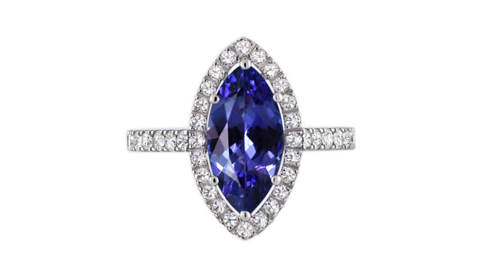 Rare African Tanzanite Marquise and Diamond Halo Ring | A marquise shaped tanzanite, surrounded by a halo of diamonds with a sparkling diamond band, set in 18 carart white gold.