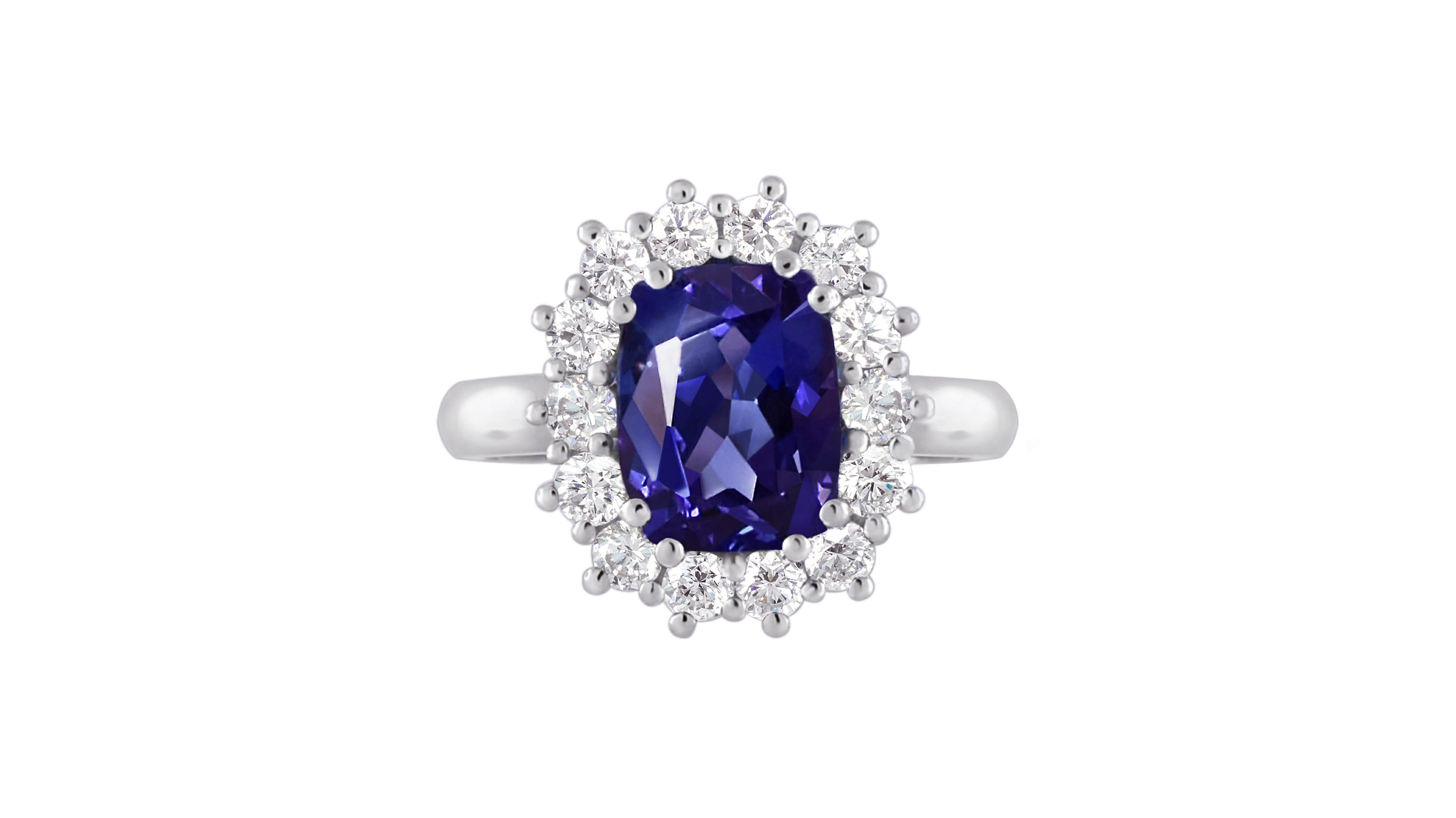 Rare african tanzanite and diamond ring| Vivid violet blue cushion tanzanite and diamond ring set in 18 carat white gold