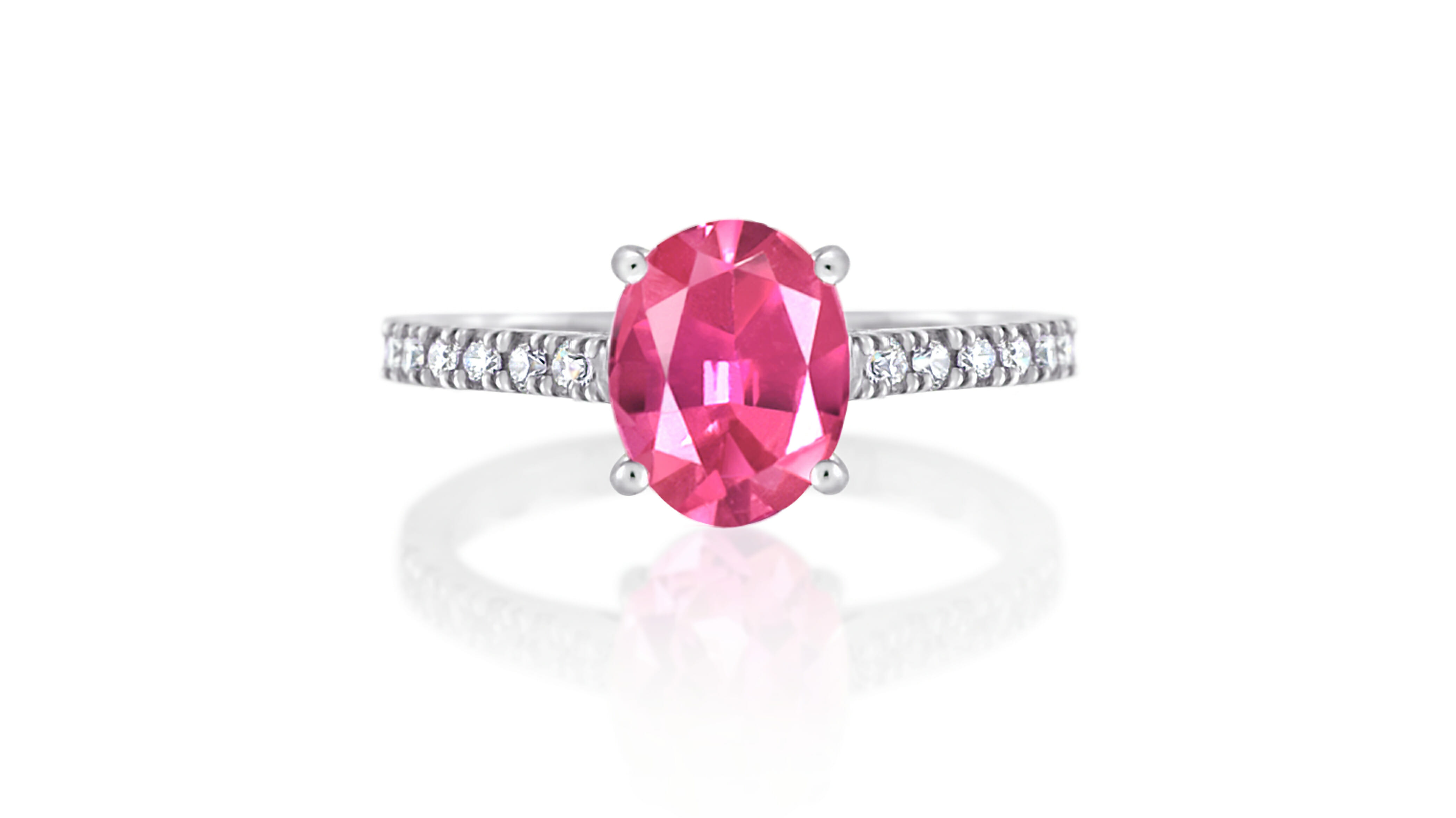 Pink oval tourmaline coloured gemstone ring with diamonds extending down the band | Set in 18 carat white gold