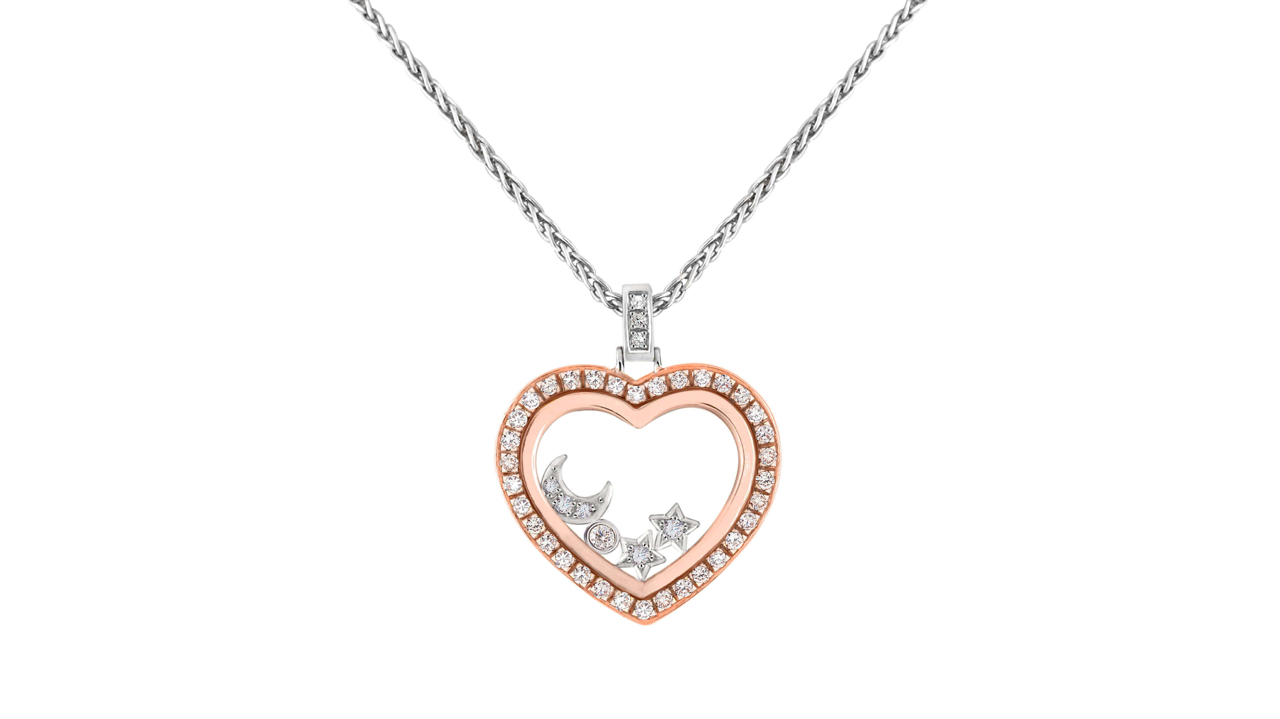 Enchanted Diamond Starry Night Pendant | Rose gold enchanted diamond halo heart pendant, with white gold moon and star diamond charms encased in crystal. Surrounded by a halo of diamonds.