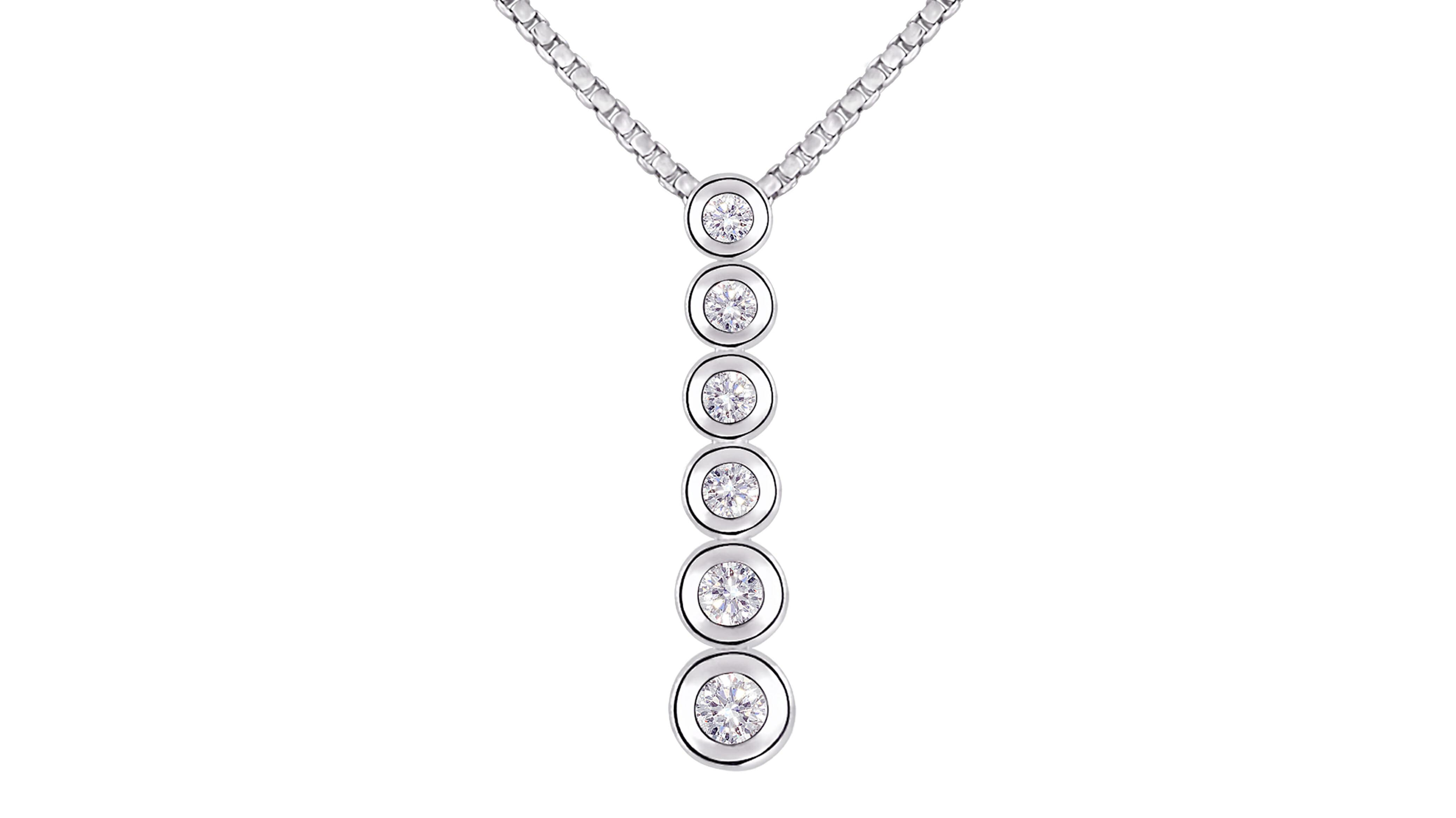 18 carat white gold, graduated tube-set diamond pendant