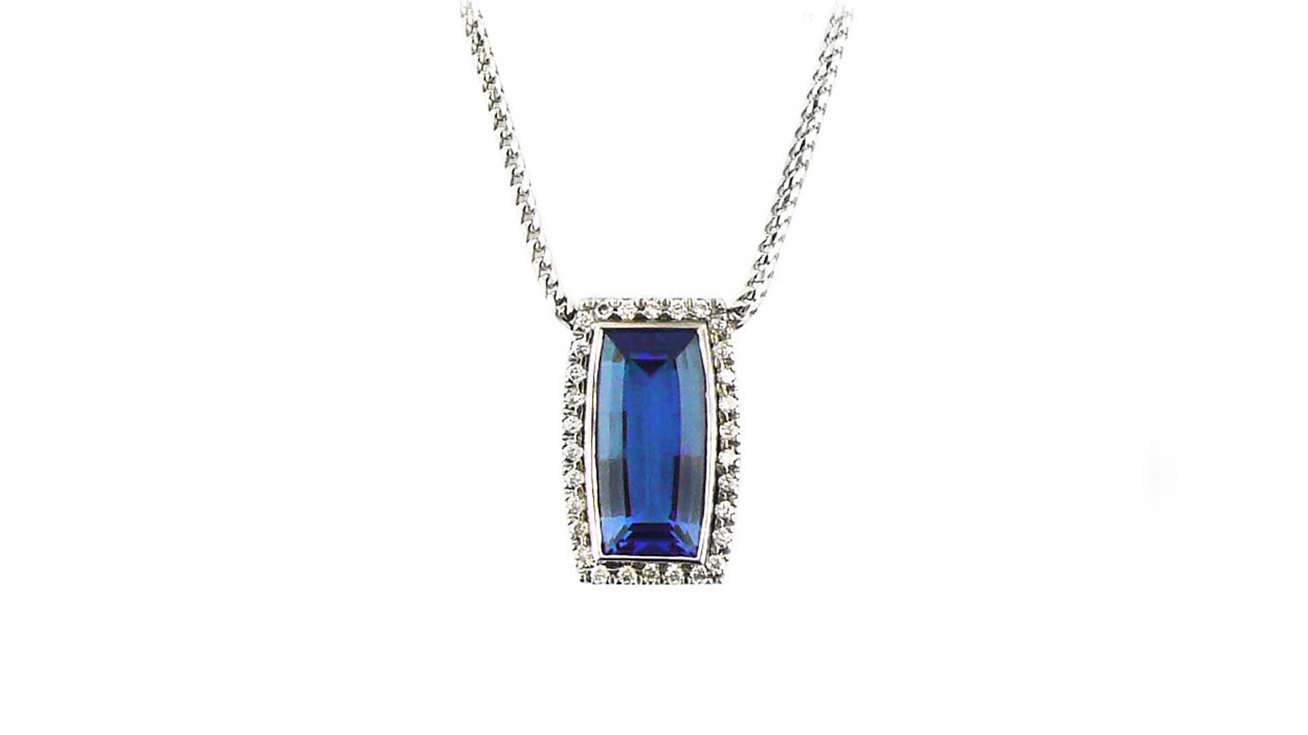 Princess cut rare african tanzanite and diamond halo pendant