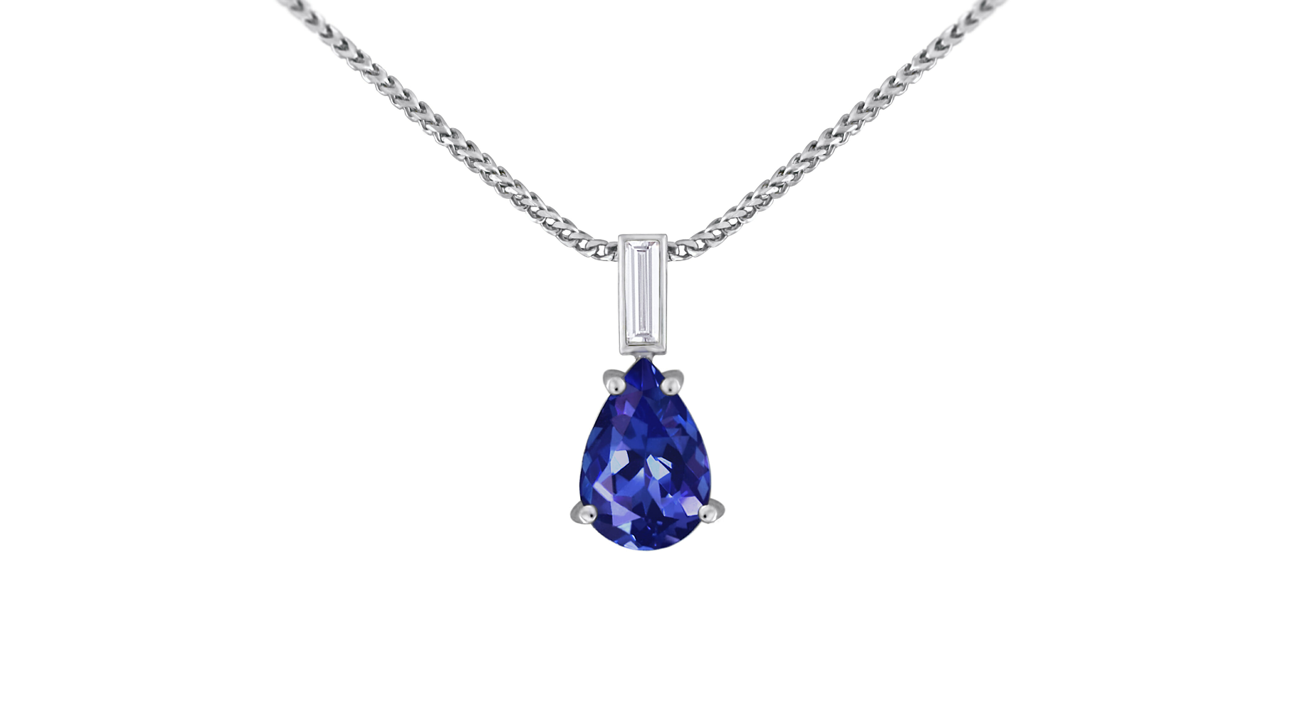 A pear cut rare african tanzanite and baguette cut diamond drop pendant