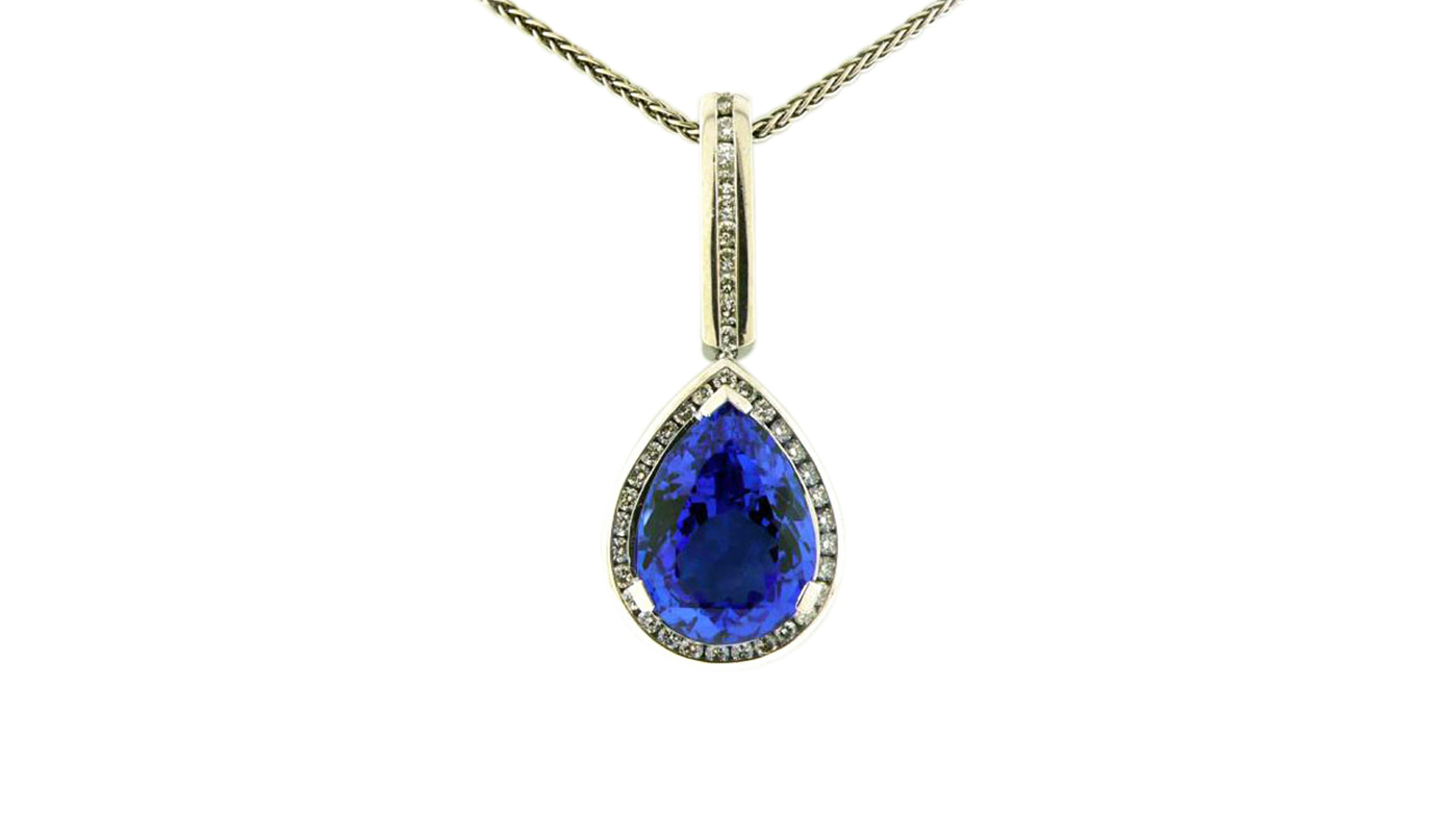 Pear tanzanite and diamond halo pendant with diamond bale