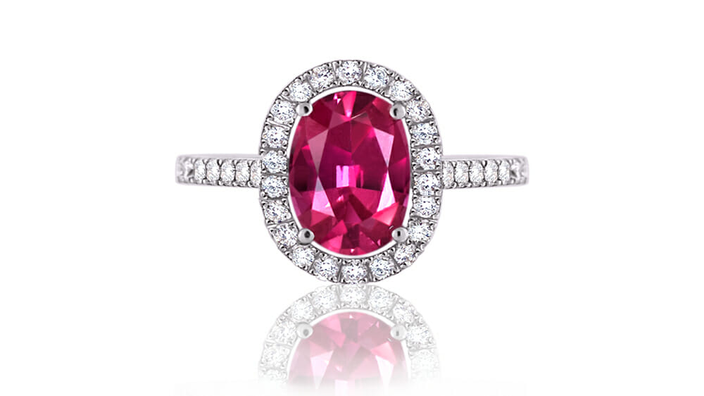 Vibrant pink tourmaline coloured gemstone and diamond halo ring