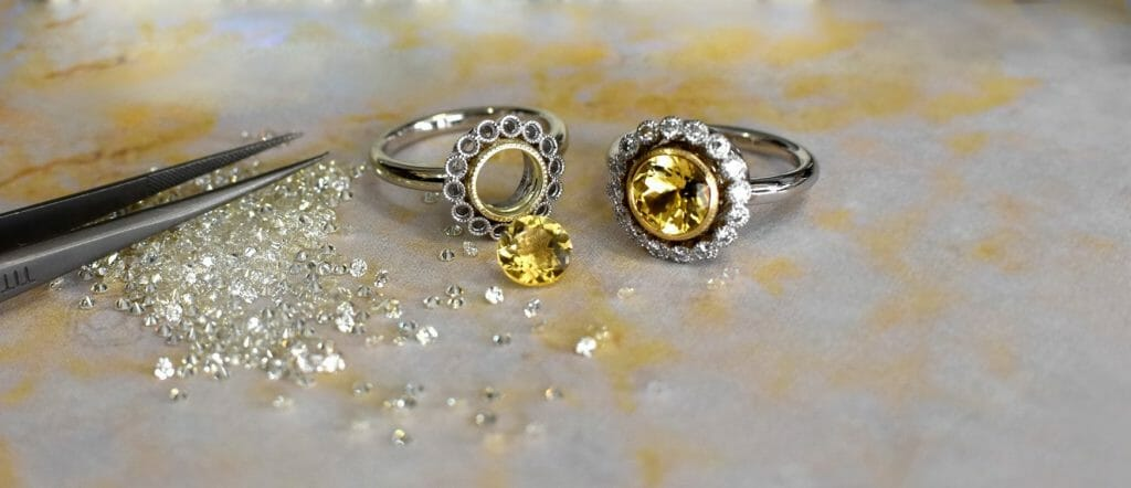 Ring with loose diamonds and yellow danburite