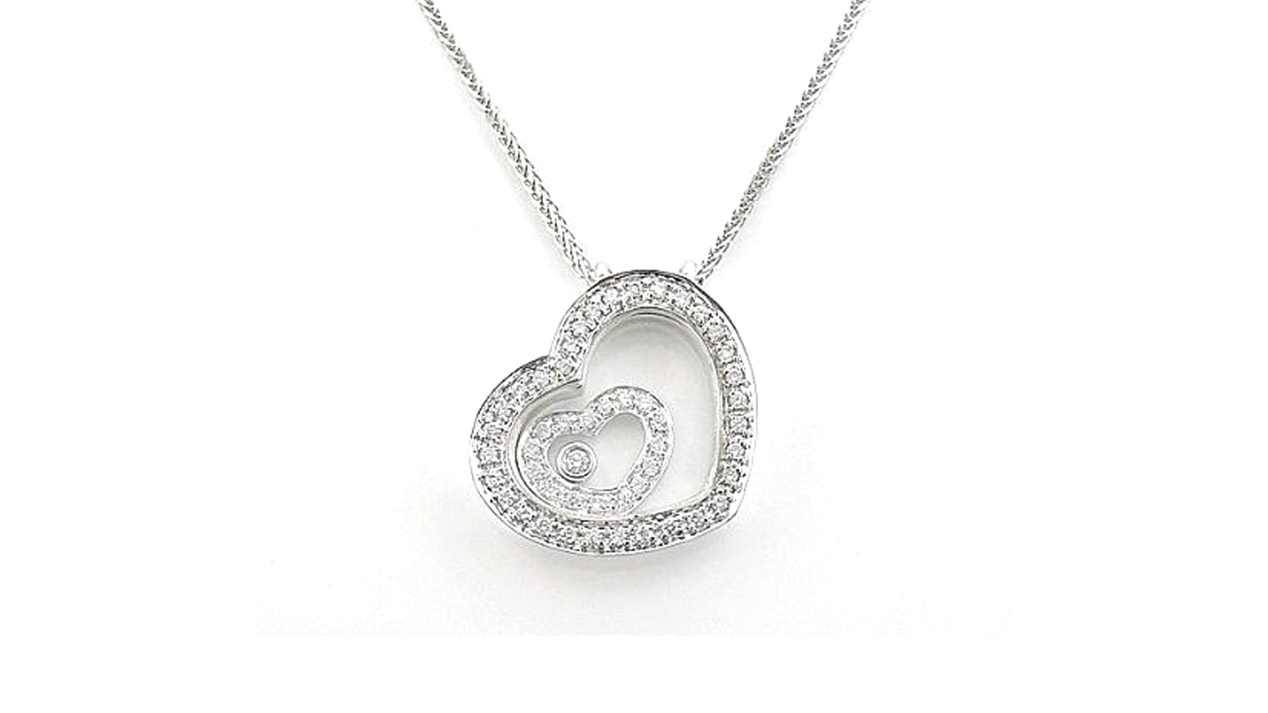 Enchanted diamond heart within a diamond heart diamond pendant encased in cystal