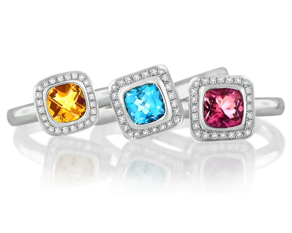 Diamond & Gemstone Jewellery Collection | Trio of coloured gemstone rings surrounded by a halo of diamonds, set in 18 carat white gold