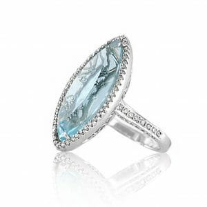 blue topaz diamond halo dress ring with intricate design on gallery of ring