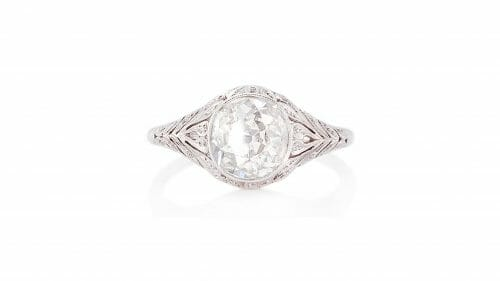 Antique Old Cut Diamond Ring   A floral vinatge-style design in platinum with a 1.35ct old mine cut diamond