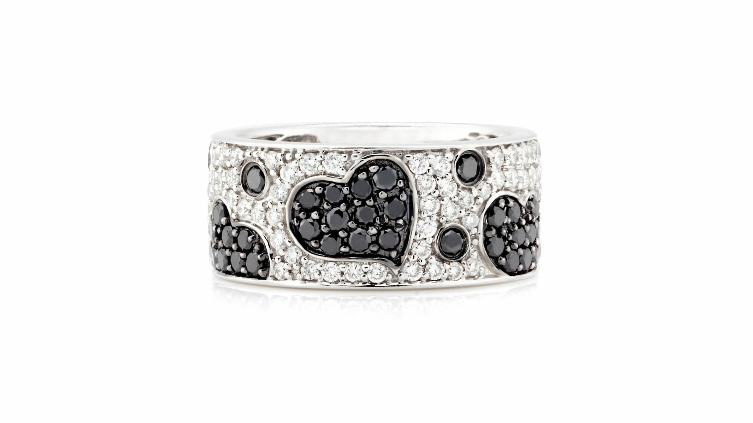 Black & White Diamonds Pavé Hearts Ring | Black & White Diamond Dress Ring Set In 18 Carat White Gold With Black And WHite Pavé-Set Diamonds In Heart Shapes