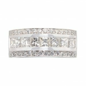 Princess cut & round diamond dress ring | 8 princess cut stones and 38 brilliant round diamond set in 18ct white gold.