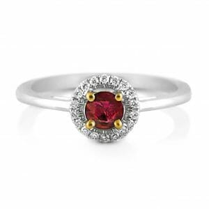Ruby & Diamond Halo Ring | A Ruby Set In 18ct Yellow Gold Claws With A Diamond Halo In 18ct White Gold
