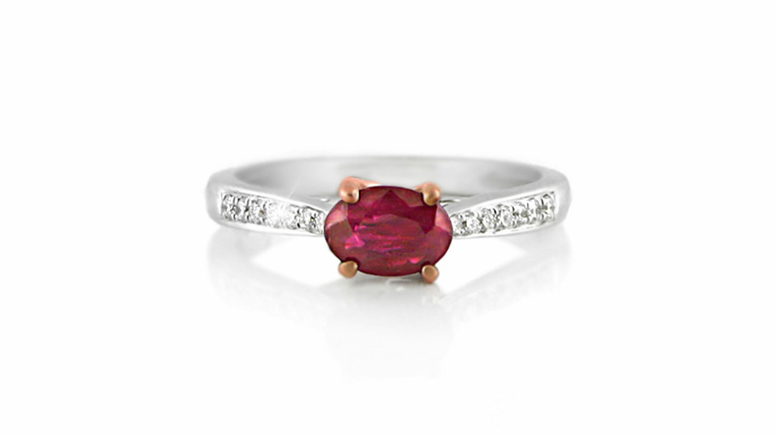 Ruby & diamond ring | An 18ct White Gold Ring Heralding An Oval Cut Ruby With Diamonds Extending Down The Band