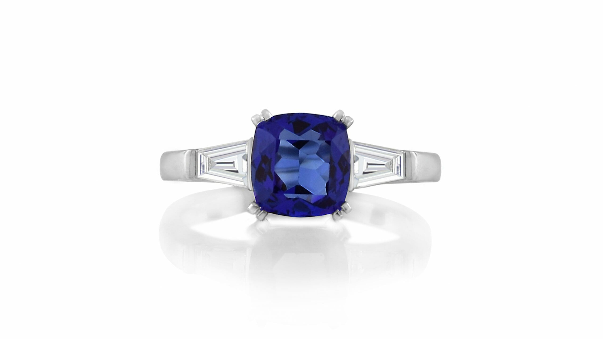 Rare African Tanzanite & Tapered Baguette Diamond RIng | Platinum ring heralds a violet blue, vivid + tanzanite & two side tapered baguette diamonds