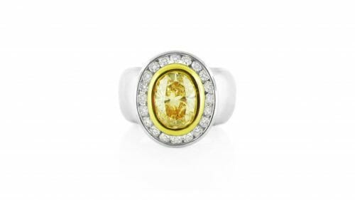 Oval Yellow Diamond Dress Ring | A tube-set centre stone surrounded by a halo of diamonds. Can ne custom designed to your specifications.
